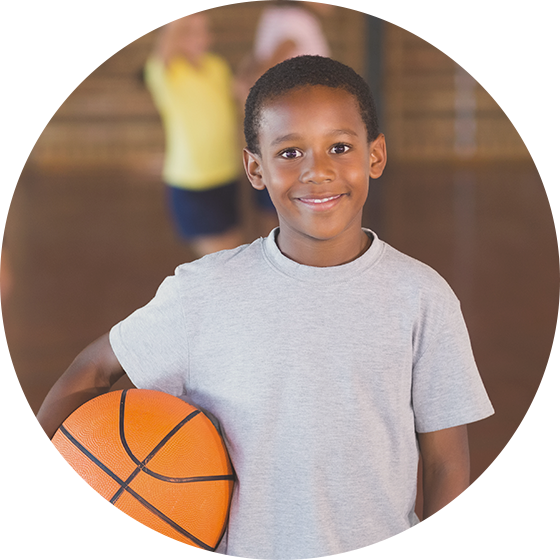 Kid standing with a basketball